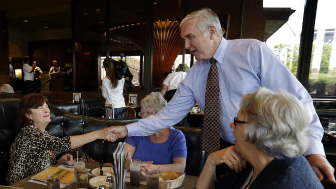 Republican U.S. Senate hopeful Michael Sullivan greets diners at Christo's in Brockton, Mass., Monday, April 29, 2013. Three Republicans and two Democrats seeking the nominations of their parties to run in a special U.S. Senate election to fill the Massachusetts seat formerly held by Secretary of State John Kerry are making a final pre-primary push for votes. A light turnout is expected for Tuesday's primary. (AP Photo/Elise Amendola)