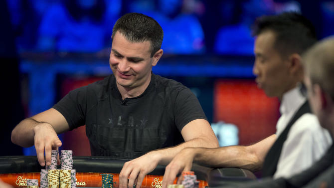 Andras Koroknai of Debrecen, Hungary, stacks his chips between hands during the World Series of Poker Final Table event, Monday, Oct. 29, 2012, in Las Vegas. (AP Photo/Julie Jacobson)