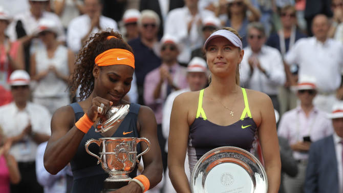 Serena Williams, of the U.S, left, opens the winner's cup after defeating Russia's Maria Sharapova after the Women's final match of the French Open tennis tournament at the Roland Garros stadium Saturday, June 8, 2013 in Paris. Williams won 6-4, 6-4. (AP Photo/Michel Euler)