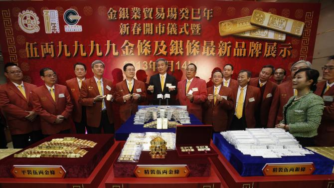 Chinese Gold and Silver Exchange Society President Cheung speaks during the first trading day in Hong Kong