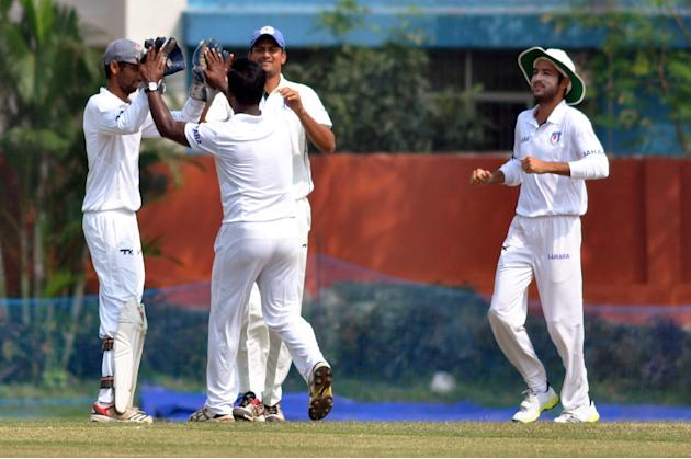 UPCA XI players celebrate fall of a wicket during Day 2 of practice match between West Indies and Uttar Pradesh Cricket Association XI at the Jadavpur University Ground in Kolkata on Nov.1, 2013. (Pho
