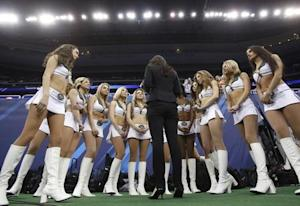 New York Jets cheerleaders are interviewed during Media Day for Super Bowl XLVIII at the Prudential Center in Newark