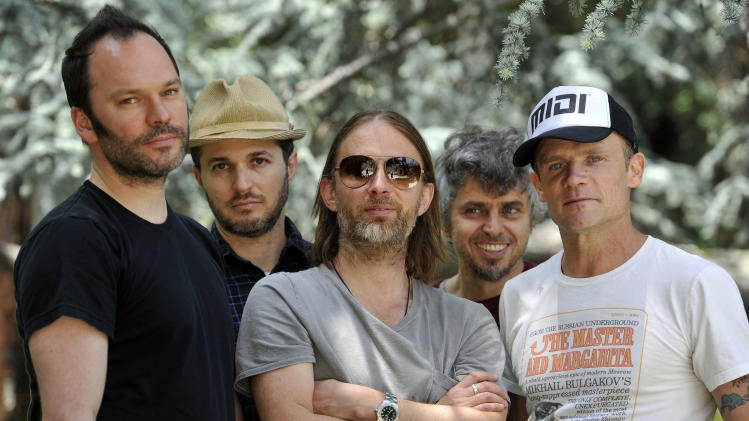 FILE - This May 22, 2013 file photo shows members of Atoms For Peace , from left, Nigel Godrich, Joey Waronker, Thom Yorke, Mauro Refosco and Flea in Los Angeles. Yorke and Godrich announced Sunday, July 14, on Twitter they're pulling their Atoms For Peace collaboration off the streaming service Spotify over royalty payments they say are paltry. (Photo by Chris Pizzello/Invision/AP, File)