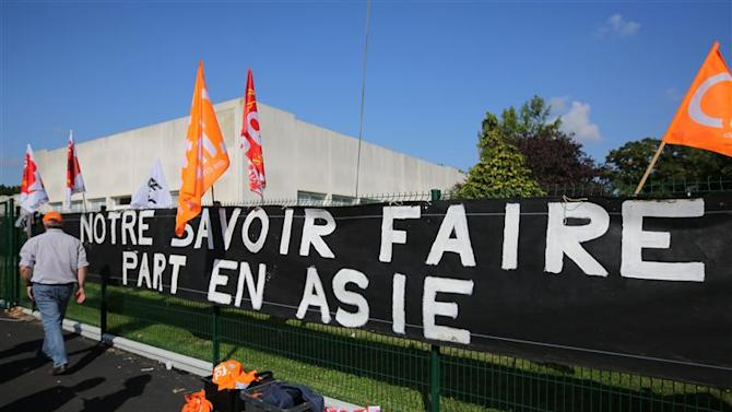 Employees of Alcatel-Lucent demonstrate in front of the company site in Orvault near Nantes, western France
