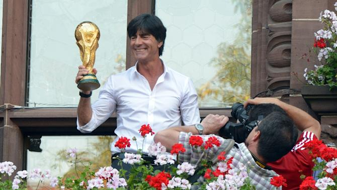 Joachim Loew displays the World Cup trophy on September 9, 2014, two months after leading Germany to glory in Brazil