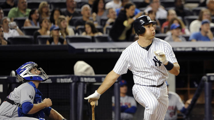 New York Mets catcher Josh Thole, left, watches as New York Yankees' Mark Teixeira, right, hits a two-run home run off Mets starting pitcher Dillon Gee in the sixth inning of an interleague baseball game on Saturday, June 9, 2012, at Yankee Stadium in New York. (AP Photo/Kathy Kmonicek)