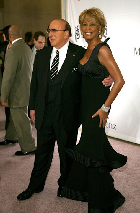 OCTOBER 28: Producer Clive Davis (L) and singer Whitney Houston arrive at the 17th Annual Mercedes-Benz Carousel of Hope Ball at the Beverly Hilton Hotel on October 28, 2006 in Beverly Hills, Californ