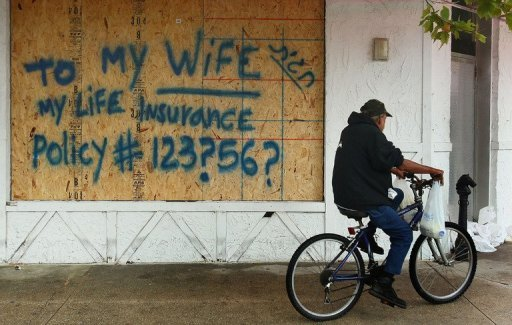 Shopkeepers boarded up stores ahead of Hurricane Irene in Ocean City, Maryland
