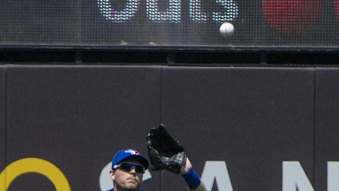 Toronto Blue Jays' fielder Michael Saunders prepares to make a catch against the Cleveland Indians, during a baseball game in Cleveland, Sunday, May 3, 2015. (AP Photo/Phil Long)