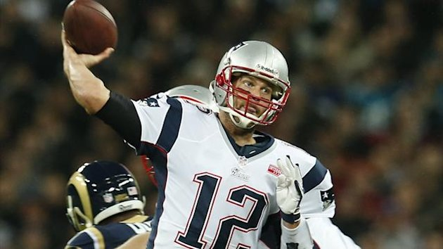 New England Patriots quarterback Tom Brady throws a pass against the St. Louis Rams in the first quarter during their NFL football game at Wembley Stadium
