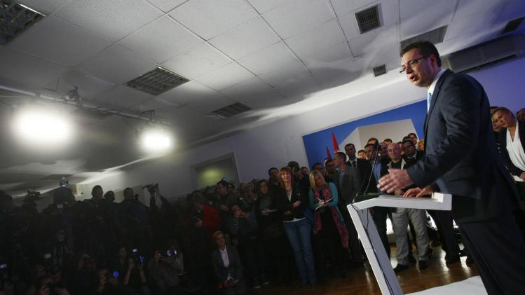 Serbian Deputy Prime Minister and the leader of Serbian Progressive Party Vucic addresses the media at the party headquarters in Belgrade