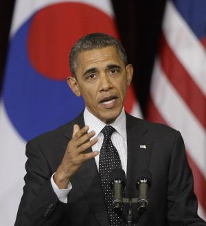 ALTERNATE CROP OF NSS104 - U.S. President Barack Obama delivers a speech at Hankuk University in Seoul, South Korea, Monday, March 26, 2012. (AP Photo/Lee Jin-man)