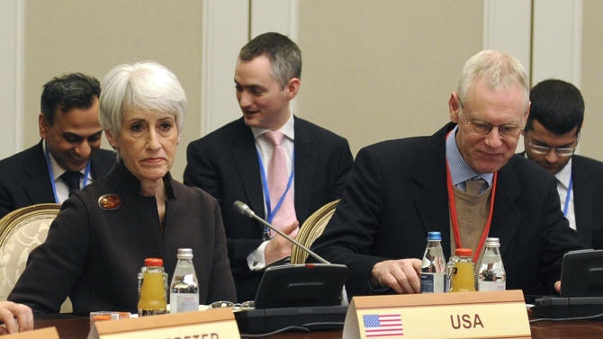 U.S. Under Secretary for Political Affairs Wendy Sherman, left, and Political Director of the Ministry of Foreign Affairs of the United Kingdom Simon Gass, right, listen during talks on Iran's nuclear program in Almaty, Kazakhstan Wednesday, Feb. 27, 2013.   World powers hope Iran will respond positively on Wednesday to their new offer to lift some sanctions if Tehran scales back nuclear activity the West fears could be used to build bombs. (AP Photo/Ilyas Omarov, Pool)