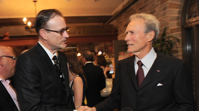 EXCLUSIVE CONTENT - Geffen Playhouse managing director Ken Novice, left, and Clint Eastwood attend the Backstage at the Geffen gala at the Geffen Playhouse on Monday, May 13, 2013, in Los Angeles. (Photo by Jordan Strauss/Invision for Geffen/AP Images)