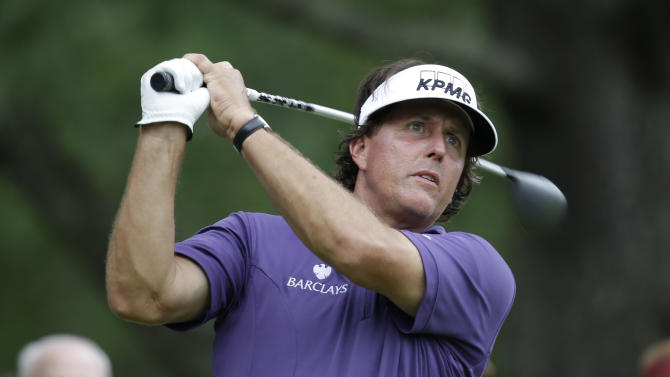 Phil Mickelson watches his tee shot on the ninth hole during the second round of the Greenbrier Classic PGA tour tournament in White Sulphur Springs, W.Va., Friday, July 5, 2013. Mickelson finished the round at 2 over par for the tourney. (AP Photo/Steve Helber)