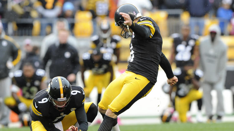 Pittsburgh Steelers kicker Shaun Suisham (6) kicks a 34-yard field goal out of the hold by  Drew Butler as time runs out in the fourth quarter to win an NFL football game on Sunday, Oct. 7, 2012, in Pittsburgh. Pittsburgh won 16-14. (AP Photo/Don Wright)