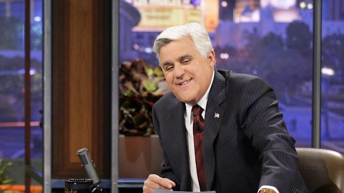 """This Nov. 5, 2012 photo released by NBC shows Jay Leno, host of """"The Tonight Show with Jay Leno,"""" on the set in Burbank, Calif. As Jay Leno lobs potshots at ratings-challenged NBC in his """"Tonight Show"""" monologues, speculation is swirling the network is taking steps to replace the host with Jimmy Fallon next year and move the show from Burbank to New York.  NBC confirmed Wednesday, March 20, it's creating a new studio for Fallon in New York, where he hosts """"Late Night."""" But the network did not comment on a report that the digs at its Rockefeller Plaza headquarters may become home to a transplanted, Fallon-hosted """"Tonight Show.""""  (AP Photo/NBC, Paul Drinkwater)"""