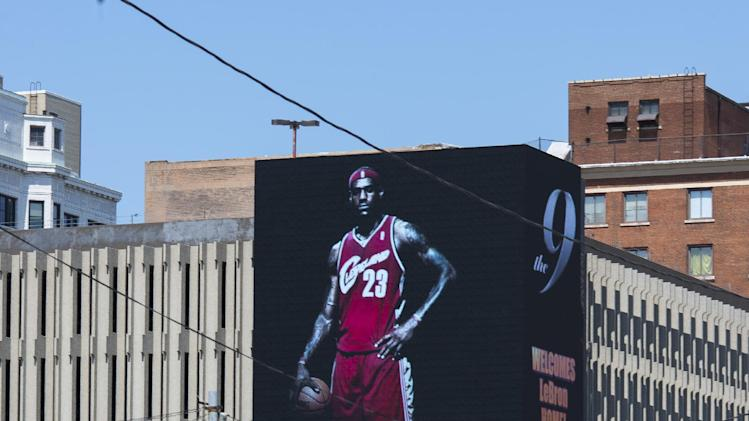 An image of Lebron James is displayed on a billboard in downtown Cleveland after he announced his return to Cleveland on July 11, 2014