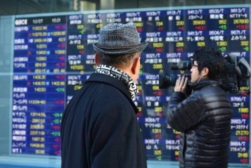 <p>People pass an electronic share price board in Tokyo. Asian markets climbed on Thursday after China released better-than-expected trade data that provide further evidence the world's number two economy has emerged from a drawn-out slumber.</p>