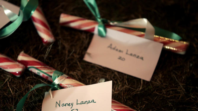 The names of Nancy Lanza and Adam Lanza are attached to candy at a memorial to the Newtown shooting victims in Newtown, Conn., Thursday, Dec. 20, 2012. Nancy Lanza's 20-year-old son, Adam Lanza, killed her at their home in Newtown, Conn., last week and then drove to Sandy Hook Elementary School, where he killed 20 children and six school employees before committing suicide. (AP Photo/Seth Wenig)