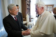 "Pope Benedict XVI (right) greets Nguyen Phu Trong -- the secretary general of Vietnam's Communist Party -- during a private audience at the Vatican on January 22, 2013. The pontiff met Trong in an unusual gesture marking a desire for ""fruitful collaboration"" between the Catholic Church and the Communist Party, though some issues remain to be resolved"