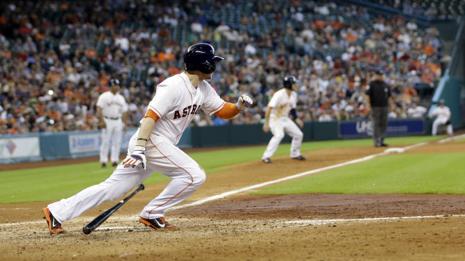 Houston Astros' Alex Presley (8) hits a two-run single against the Seattle Mariners during the fifth inning of a baseball game Sunday, Sept. 21, 2014, in Houston. The Astros' Robbie Grossman and Jose Altuve scored on Presley's hit. (AP Photo/David J. Phillip)