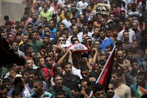 Palestinians carry the body of Mohammed Amsha, 25, …