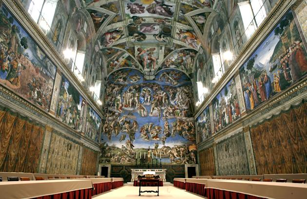 In this April 16, 2005 file photo, tables and chairs line the Sistine Chapel at the Vatican in preparation for the conclave. Five centuries after Michelangelo's ceiling frescoes were inaugurated a