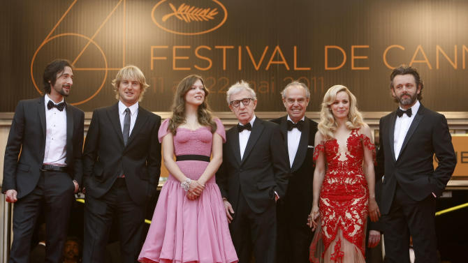 From left, Adrien Brody, Owen Wilson, Lea Seydoux, Director Woody Allen, French Culture Minister Frederic Mitterrand, Rachel McAdams, and Michael Sheen stand at the top of the steps as they arrive for the screening of Midnight in Paris and the opening ceremony, at the 64th international film festival, in Cannes, southern France, Wednesday, May 11, 2011. (AP Photo/Lionel Cironneau)