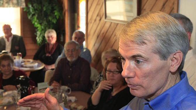 In this May 11, 2012, photo Sen. Rob Portman speaks to supportersat the Lake Manor Restaurant in Mt. Orab, Ohio. President Barack Obama and his Democratic allies aren't waiting for Republican Mitt Romney to reveal his vice presidential choice. They're already trying to scuff up those considered by political insiders to be most likely to join the GOP ticket.  The president's campaign started swinging at the potential Republican running mates, including Portman, this week while urging home-state Democrats to chime in about the shortcomings  (AP Photo/Al Behrman)