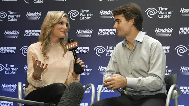 Danielle Trotta interviews Jeff Gordon at the celebration for the unveiling of the Kasey Kahne No. 5 Time Warner Chevrolet, on Wednesday, Oct. 10, 2012 in Charlotte, N.C. (Photo by Matthew T. Thacker/Invision for Time Warner Cable/AP Images)