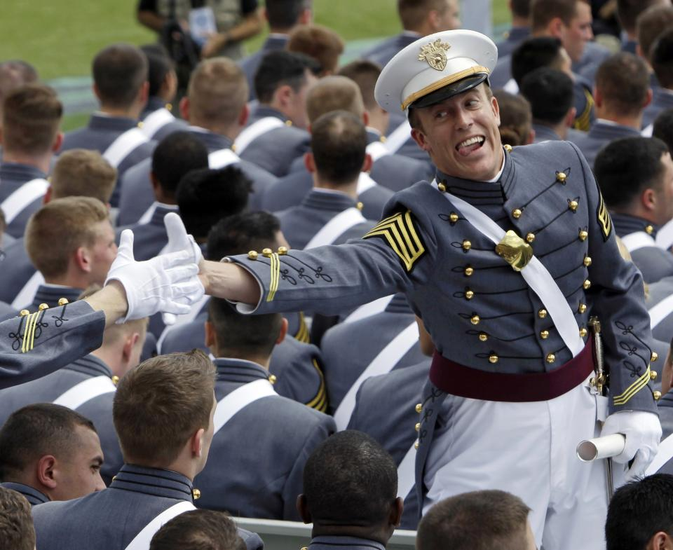 A cadet reacts after receiving his diploma during a graduation and commissioning ceremony at the U.S. Military Academy in West Point, N.Y., on Saturday, May 21, 2011.   (AP Photo/Mike Groll)