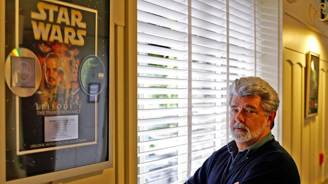 """FILE - In this May 4, 2005 file photo, George Lucas, director of """"Star Wars Episode III: Revenge of the Sith,"""" poses at Skywalker Ranch in San Rafael, Calif. The film is the last in Lucas' series of """"Star Wars"""" movies. There's no mistaking the similarities. A childhood on a dusty farm, a love of fast vehicles, a rebel who battles an overpowering empire, George Lucas is the hero he created, Luke Skywalker. (AP Photo/Eric Risberg, File)"""