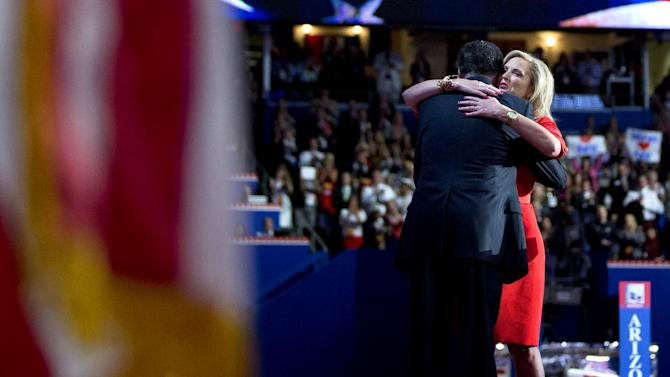 Republican presidential candidate, former Massachusetts Gov. Mitt Romney hugs his wife Ann, after she delivered a speech at the Republican National Convention on Tuesday, Aug. 28, 2012 in Tampa, Fla.  (AP Photo/Evan Vucci)