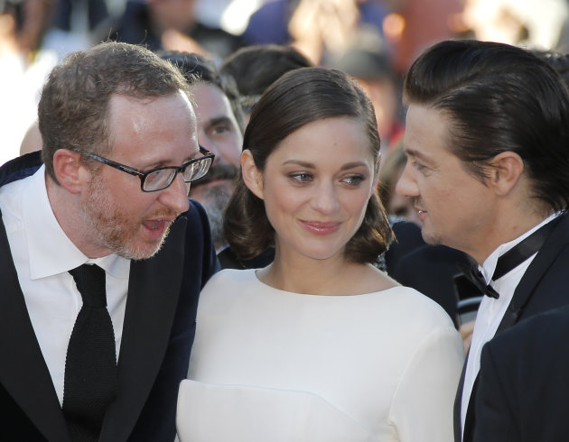 From left, director James Gray, actress Marion Cotillard, and actor Jeremy Renner speak as they arrive for the screening of The Immigrant at the 66th international film festival, in Cannes, southern F