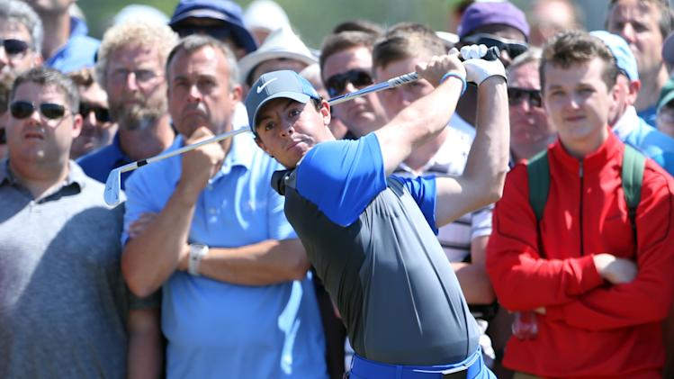 Rory McIlroy of Northern Ireland plays a shot on the 16th hole during the first day of the British Open Golf championship at the Royal Liverpool golf club, Hoylake, England, Thursday July 17, 2014