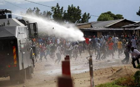 A water cannon is used by riot policemen to disperse protestors in the capital Bujumbura