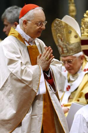 FILE - In this Nov. 21, 2010 file photo, Cardinal Mauro Piacenza walks past Pope Benedict XVI after receiving Cardinal's ring during a Mass in St. Peter's Basilica, at the Vatican. Pope Francis on Saturday effectively demoted a highly conservative Italian cardinal who led the Vatican's department on clergy, while keeping in place a German prelate who wages the Catholic church's crackdown on liberal U.S. nuns and helps craft its sex-abuse response. Francis removed Cardinal Mauro Piacenza, with a reputation for being highly traditional on matters of liturgy and the question of priestly celibacy, from the important post of prefect of the congregation for clergy. Piacenza had only held that post since 2010, when he was appointed by Francis' predecessor, Benedict XVI, whose retro tastes in papal vestments and preference for traditional ceremonies found a supporter in the Italian prelate. (AP Photo/Pier Paolo Cito, Files)