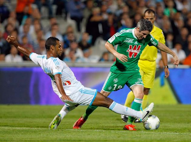 Saint-Etienne's French midfielder Fabien Lemoine, right,  challenges for the ball with Marseille's Togolese midfielder Jacques-Alaixys Romao, during their League One soccer match, at the Velodrome Sta