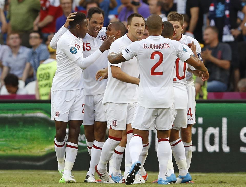 England's Joleon Lescott, second left, celebrates with teammates after scoring during the Euro 2012 soccer championship Group D match between France and England in Donetsk, Ukraine, Monday, June 11, 2012. (AP Photo/Kirsty Wigglesworth)