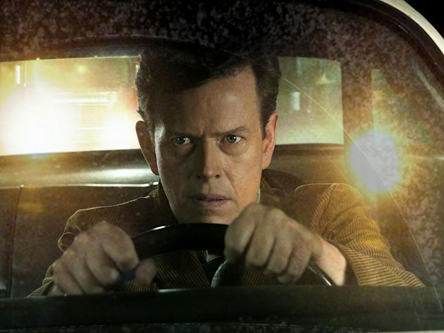 John Trimble (Dylan Baker) participates in an underground cross-country road race in Drive. 