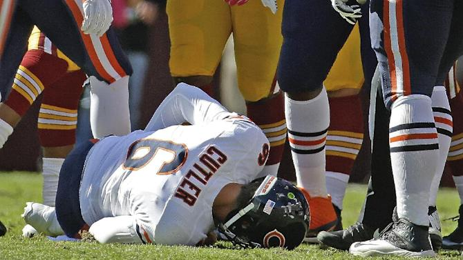 Chicago Bears quarterback Jay Cutler lies on the field after being injured in a sack by Washington Redskins defensive end Chris Baker during the first half of a NFL football game in Landover, Md., Sunday, Oct. 20, 2013. (AP Photo/Alex Brandon)