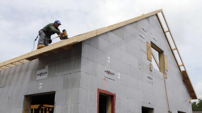 FILE - In this July 9, 2013, file photo, a construction worker drills on the roof of a new home in New Paltz, N.Y. The Commerce Department reports on new-home sales for July, on Friday, Aug. 23, 2013. (AP Photo/Mike Groll, File)