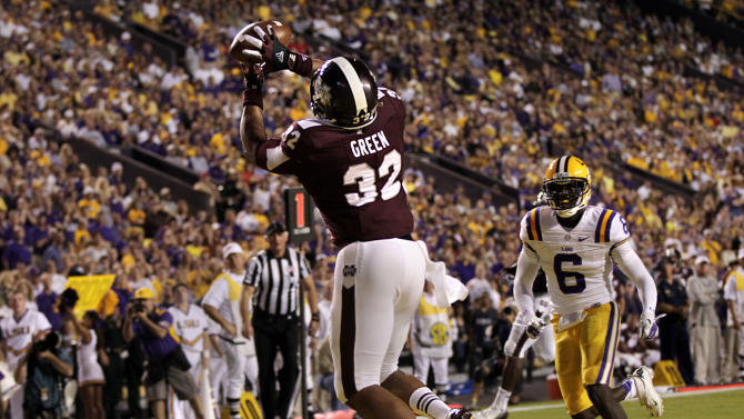 Mississippi State tight end Marcus Green (32) catches a touchdown pass in front of LSU safety Craig Loston (6) in the first half of their NCAA college football game in Baton Rouge, La., Saturday, Nov. 10, 2012. (AP Photo/Gerald Herbert)