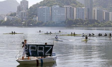 File picture shows members of the State Federation of Rowing and others taking part in a protest against violence at Rodrigo de Freitas lagoon, where a cyclist was killed the week before during a bicycle robbery, in Rio de Janeiro, Brazil