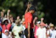 Tiger Woods reacts after making birdie on the 15th green during the final round of the AT&T National golf tournament at Congressional Country Club in Bethesda, Md., Sunday, July 1, 2012. (AP Photo/Nick Wass)