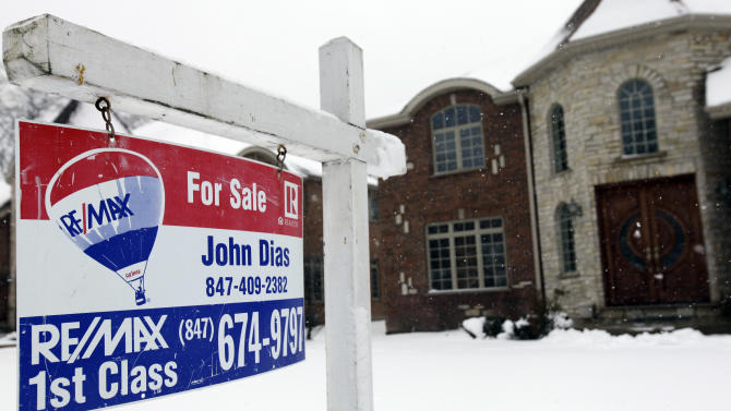 "In this Wednesday, Feb. 27, 2013, photo, a ""for sale"" sign is seen outside a home in Glenview, Ill. U.S. sales of previously occupied homes rose in February to the highest level in more than three years, further evidence of a sustained housing recovery that is benefiting the broader economy. (AP Photo/Nam Y. Huh)"