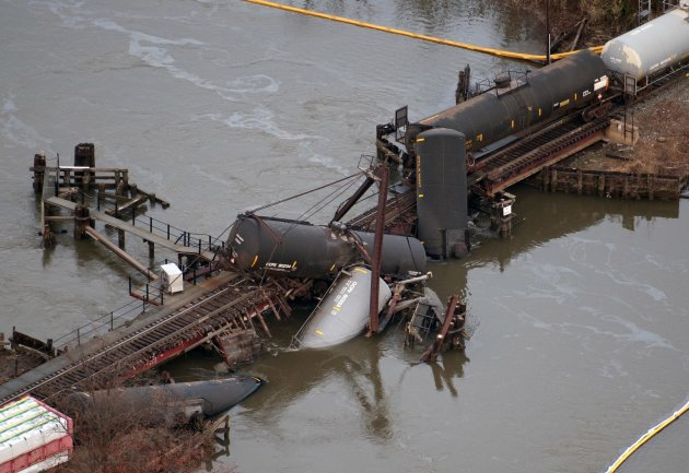 Derailed freight train cars lay in water in Paulsboro, N.J., Friday, Nov. 30, 2012. People in three southern New Jersey towns were told Friday to stay inside after the freight train derailed and several tanker cars carrying hazardous materials toppled from a bridge and into a creek. (AP Photo/Cliff Owen)
