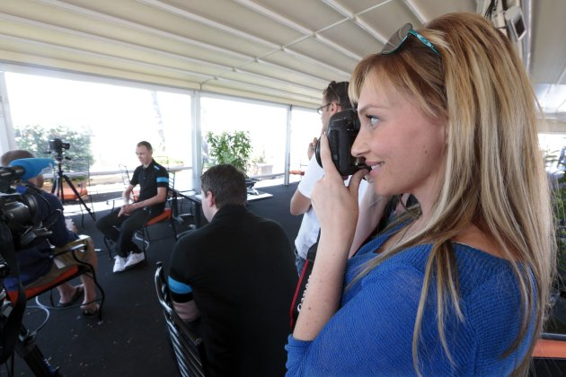 Michelle Cound, girl friend of British cyclist Christopher Froome of team Sky takes a photo during a meeting with media in Nice