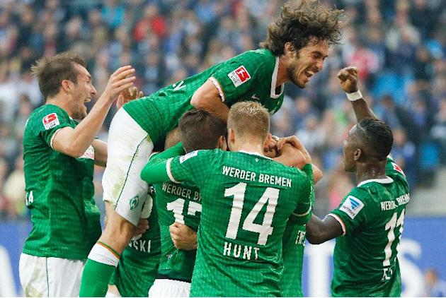 Bremen's players with Santiago Garcia at the top of the huddle celebrate the  opening goal during the Bundesliga soccer match between Hamburger SV and Werder Bremen a  in Hamburg, Germany, Saturday Se